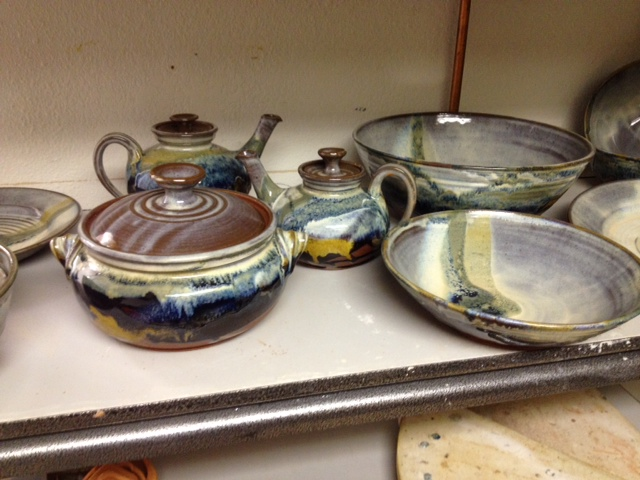 A shelf of Prairies glazed pots.