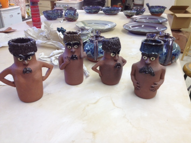 A group of grumpy looking pots.