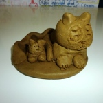 clay kitty and a friend on a clay pancake