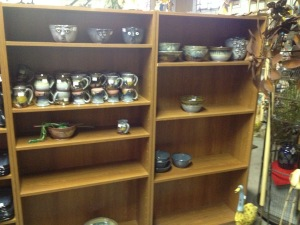 Almost empty shelves of our pottery.