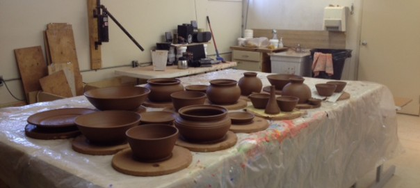 A table of an assortment of wet pots.